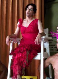 Pelton in red dress