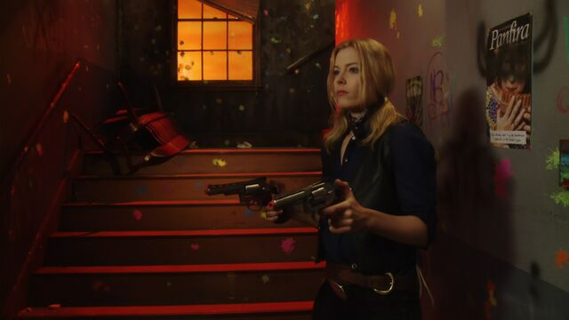 File:2x22 Britta guns wall.jpg