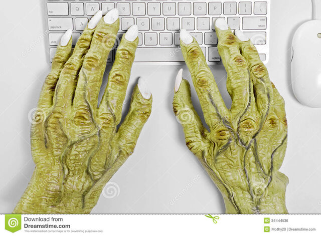File:Monster-keyboard-hands-pair-halloween-using-mouse-against-white-background-34444536.jpg