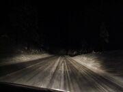 Headlights and dark road