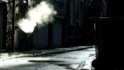 Stock-footage-steam-coming-from-outlet-in-dirty-dark-back-alley
