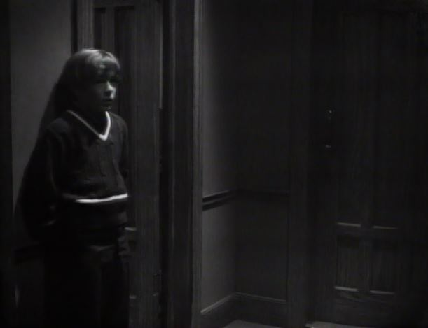 File:David listening outside Carolyn's room showing the same hallway location as Vicki's room with the door to the closed-off section nearby ep101.JPG