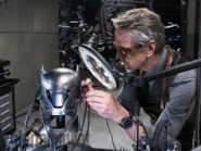 Alfred tinkering with the technology of the Batsuit's cowl