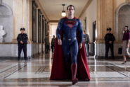 Superman strides down the halls