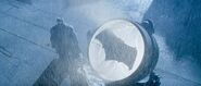 Batman stands by the Batsignal - promotional still