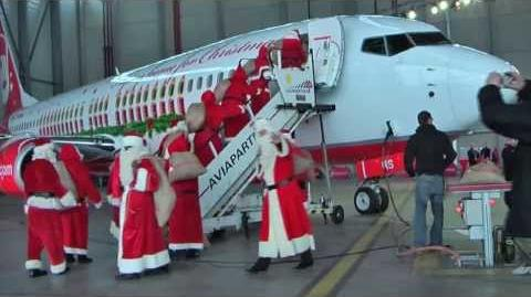 "A dozen Santa Claus visiting the Christmas aircraft ""Merry Santa"" of Air Berlin"