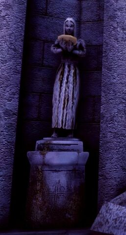 File:Statue holding bowl.jpg