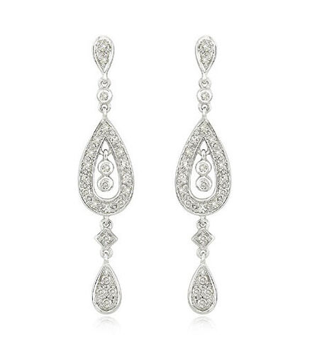 File:White-gold-diamond-earrings.jpg