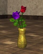 Purple and Red Roses in an Oval Vase (Visible)