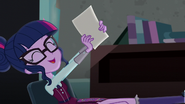 Sci-Twi leaning backwards in her chair EG3
