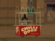 Un puesto de chilly dogs abajo