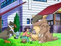 Archivo:EP569 Reggie atendiendo a los Pokémon.png