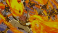 Natsu hits the soldiers with Wing Attack