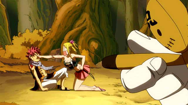 File:Kain forces Lucy to punch Natsu.png
