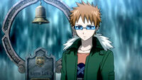 Loke stands next to Karen's grave