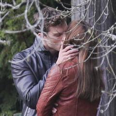 Christian kissing Ana