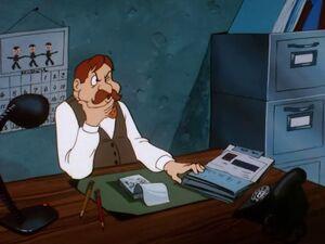 Cushette at his desk