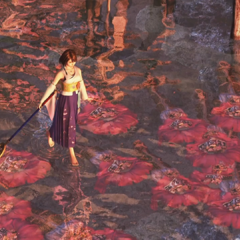 Yuna walks on water, over the caskets of the victims of Sin.