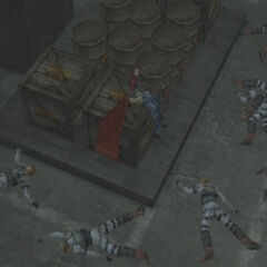 Rosso sitting on a crate surrounded by bodies.