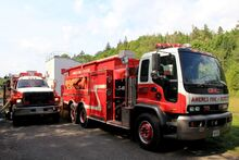 Engine 40 and Tanker 41 in front of the burn building