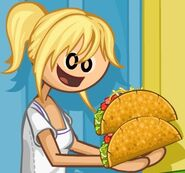 Maggie is about to eat two tacos
