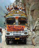 Sikh pilgrims cheering on bus to Manikaran