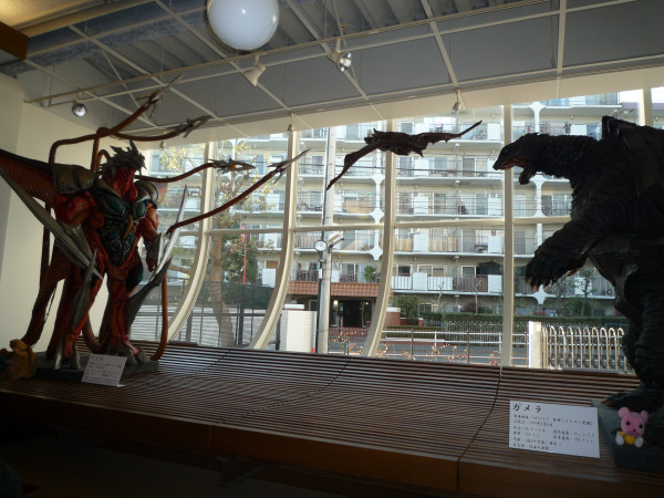 File:Gamera and Iris Suits in Cafe.jpg