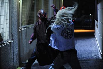 File:Sawamori battles Kotaro, who has been possessed by Ipadada.jpg