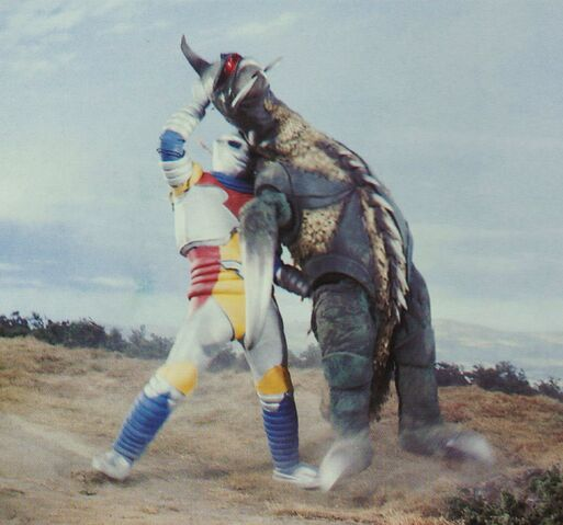 File:GVM- Jet Jaguar Lifts Gigan.jpg