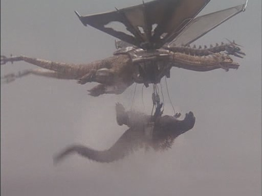 File:Mecha-King Ghidorah Carries Godzilla.jpg