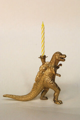File:Golden godzilla candle holder.jpg