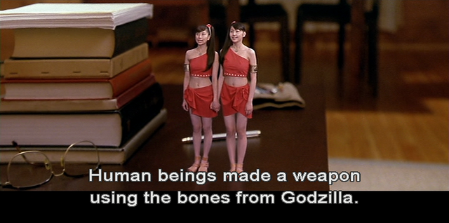 File:GMMG - Human beings created a weapon using the bones from Godzilla..png