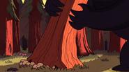 S1e1 monster picking up tree