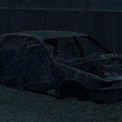 A wreck of an unknown '90s sedan in GTA IV.