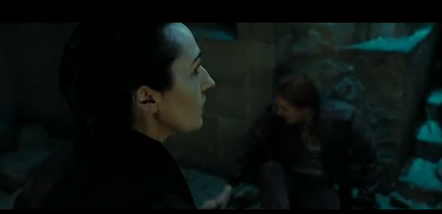 File:Female Death Eater attacks George.png