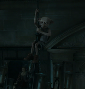 Dobby lostening the chandelier
