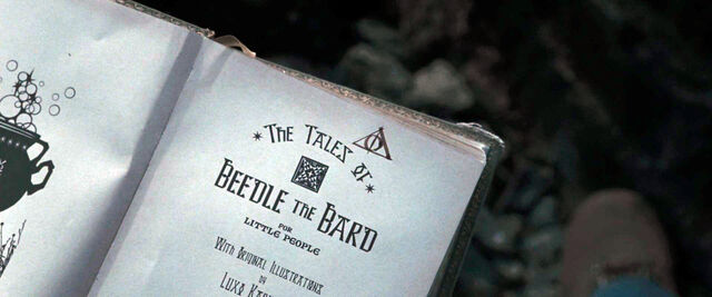 File:DH1 The Tales of Beedle the Bard 1st page, Deathly Hallows symbol.jpg