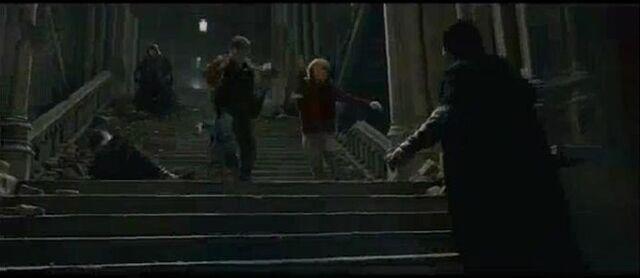 File:Trio dueling Battle og Hogwarts.jpg