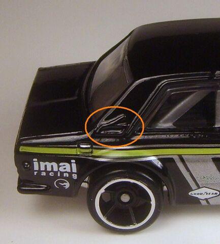 File:2009 037 Datsun Bluebird black flaw.JPG