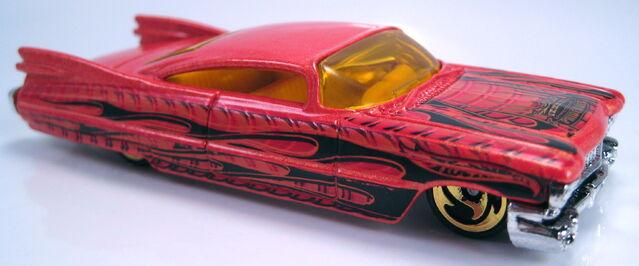 File:Custom 59 cadillac pride rides series chrome mal base gold dw3 wheels 2003.JPG