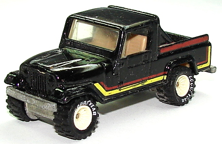 File:Jeep Scrambler BlkRR.JPG