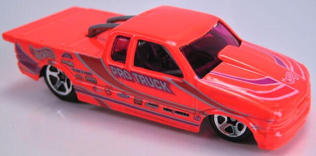 File:Chevy pro stock truck neon orange malaysia base 2000.JPG