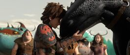 Hiccup and Toothless with their heads touching