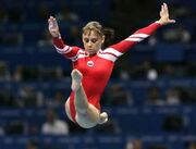 Russia's Liudmila Ezhova performs on the balance beam