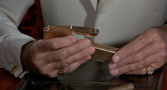File:TMWTGG - Scaramanga assembes his Golden Gun.jpg