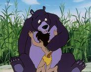 Mowgli hugs Baloo