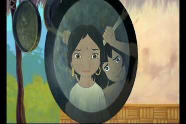 Shanti and Mowgli are both looking in a mirror