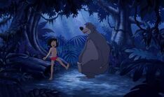 Baloo the Bear and Mowgli danceing