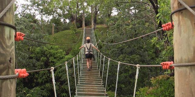 File:Girl-rope-bridge.jpg