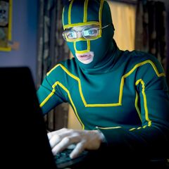 Kick-Ass on his laptop.